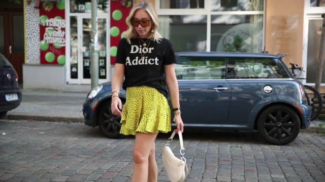 sonia lyson wearing fur sildes ducie yellow mini skirt with dots print topshop dior addict tshirt dior saddle bag wald berlin earring necklace louis... - necklace stock videos & royalty-free footage