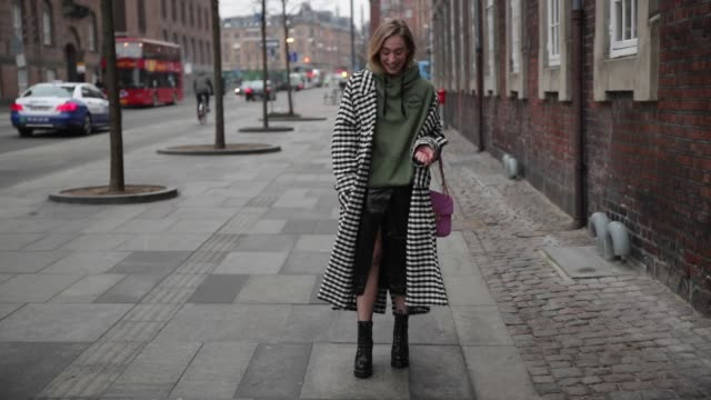 Sonia Lyson wearing Oversized Sweatshirt Topshop Duster Coat checked Topshop Vinyl skirt HM Trend Mesh tights Calzedonia Boots Zara Bag Gucci during...