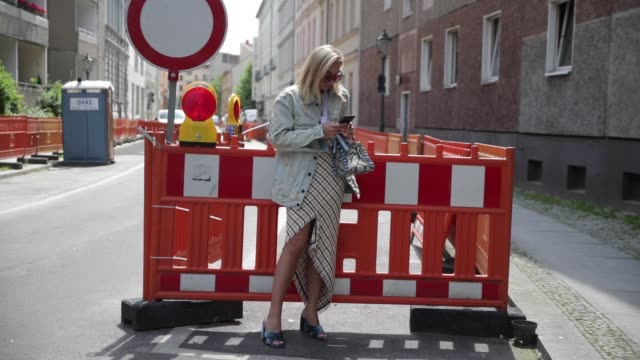 sonia lyson wearing velvet mules raye via revolve plaid topshop skirt with slit tshirt zoe karssen denim jacket alexander wang mcm sunglasses a fendi... - mule stock videos & royalty-free footage