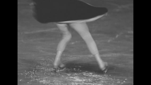 VS Sonja Henie performing figure skating routine on ice rink / CU Henie talking to camera / Note exact day not known
