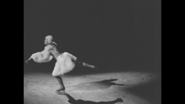 sonja henie performs on the ice mimicking ballet steps including toe step skating during ice show in new york vo music from the swan by camille... - en pointe stock videos and b-roll footage