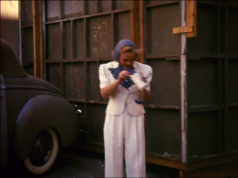 sonja henie standing outdoors eating ice cream laughing - classic car stock videos and b-roll footage