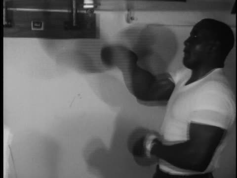sonny liston works out with a speedball. - sport stock videos & royalty-free footage