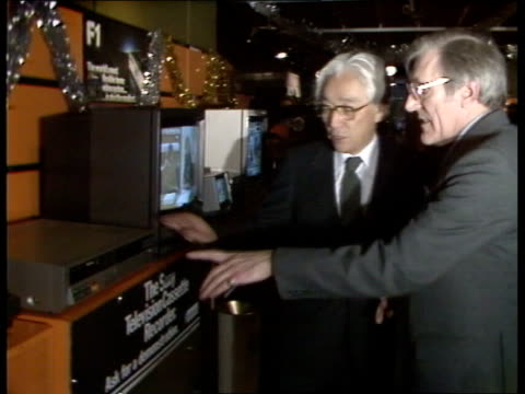 akio morita england london akio morita arrives at sony centre ms mr morita looking around shop various sony machines seen cs sony walkman ms akio... - sony stock videos & royalty-free footage