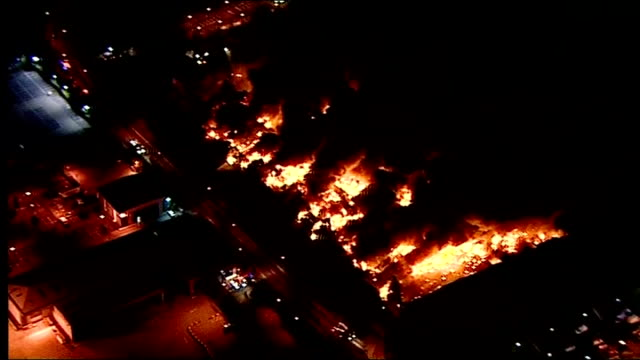 sony distribution warehouse destroyed in london riots is rebuilt; lib / ext / night air views of burning warehouse lib / day various shots of cherry... - warehouse点の映像素材/bロール