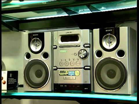 sony electronic products on shelves in sony store including hifi music systems and portable cd radio players compact disc stereo systems music... - hi fi stock videos & royalty-free footage