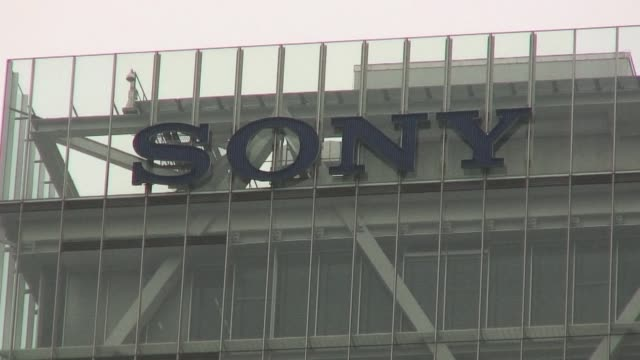 vídeos de stock, filmes e b-roll de sony posts a six month net profit of almost $10 billion crediting its playstation videogame unit and a weak yen for a big improvement in its finances... - 0 1 mês