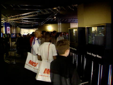 sony short of playstation games lib london olympia boys looking at games consoles at exhibition - sony stock videos & royalty-free footage