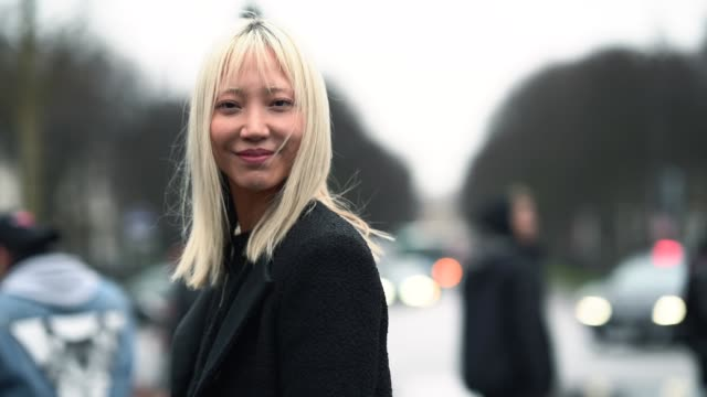soo joo park, model, wears a blazer jacket, a black top, a skirt, black thigh high boots, outside chanel, during paris fashion week -haute couture... - thigh human leg stock videos & royalty-free footage