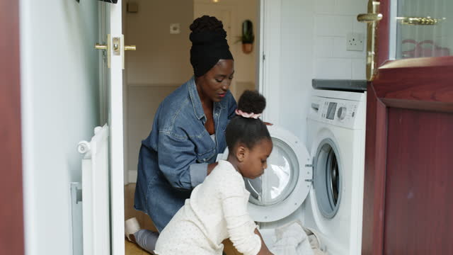 soon she'll be able to do it all by herself! - chores stock videos & royalty-free footage