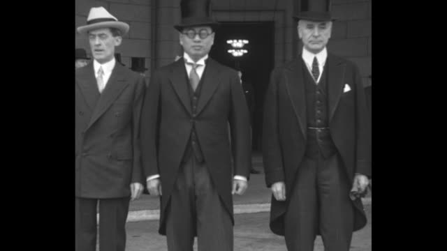 t v soong and cordell hull walk away from union station stop and stand together for photo opportunity / cu soong and hull shake hands and speak to... - cordell hull stock videos and b-roll footage
