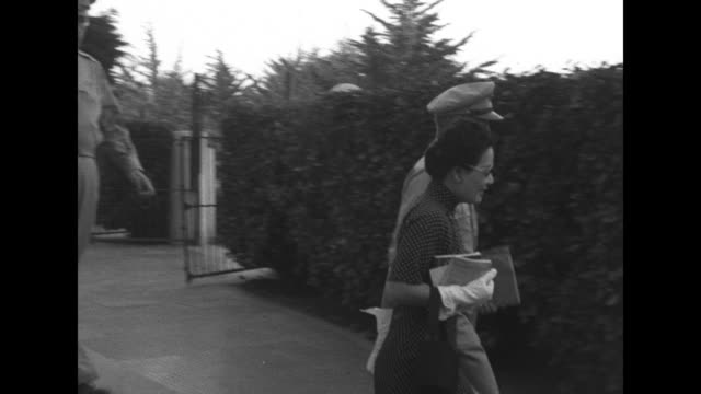 soong meiling aka madame chiang kaishek wears sunglasses as she leaves guest house with american military officers / she and women in red cross... - rotes kreuz organisierte gruppe stock-videos und b-roll-filmmaterial
