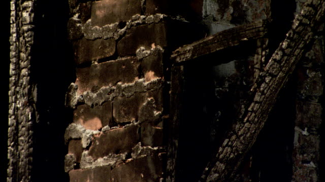 soot covers the brick wall of a burnt out house. available in hd. - soot stock videos & royalty-free footage