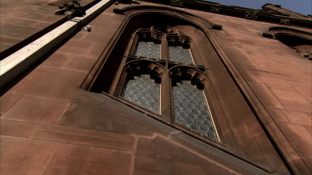 soot covers the windows and exterior of the john rylands library in manchester england. available in hd. - soot stock videos & royalty-free footage