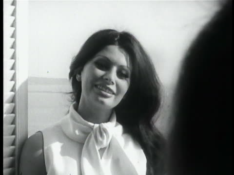 sophia loren speaking to someone as she stands in window or door of her hotel in front of sea at cannes - sophia loren stock videos & royalty-free footage