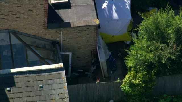 Sabrina Kouider admits attacking nanny but denies murder LIB / ENGLAND London Southfields Forensic tent in garden where badly burned body was found