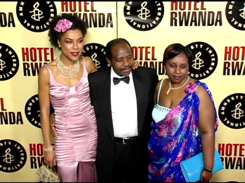 sophie okonedo, paul rusesabagina and wife at the 'hotel rwanda' los angeles premiere at the academy theatre in los angeles, california on december... - sophie okonedo stock videos & royalty-free footage