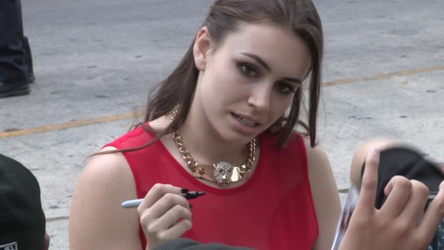 sophie simmons greets fans at the red 2 premiere at westwood village in los angeles, 07/11/13 - westwood village stock videos & royalty-free footage