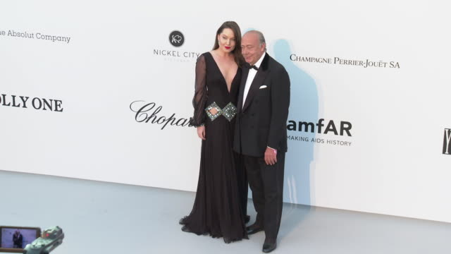 Sophie Taylor and Fawaz Gruosi at the amfAR Cannes Gala 2019 Arrivals at Hotel du CapEdenRoc on May 23 2019 in Cap d'Antibes France