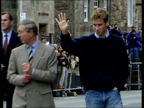 sophie wessex pregnancy announced; lib scotland: st andrews: ext prince charles & prince william along during walkabout lib england: london: int... - st. andrews scotland stock videos & royalty-free footage