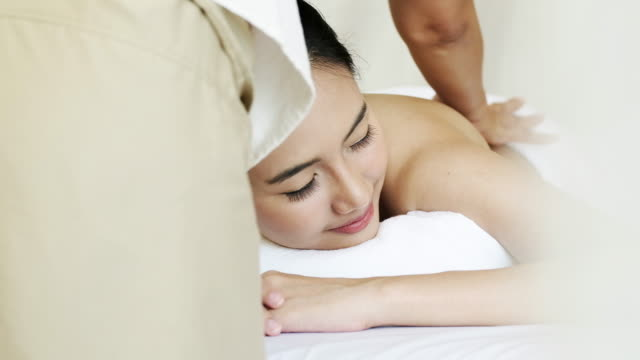 sophisticated lady relaxing with massage for healthy - afc women's asian cup stock videos and b-roll footage