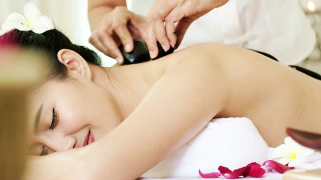 sophisticated spa treatment and massage for relaxation. - naked stock videos & royalty-free footage