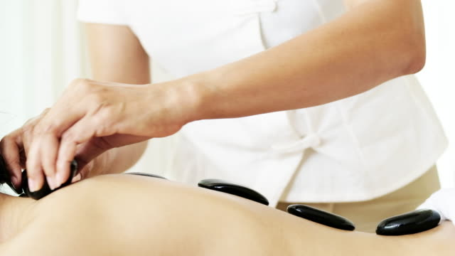 sophisticated spa treatment and massage for relaxation. - lastone therapy stock videos & royalty-free footage