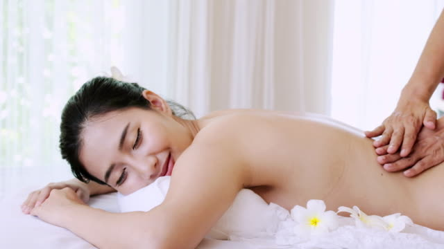 sophisticated spa treatment and massage for relaxation. - massage table stock videos and b-roll footage