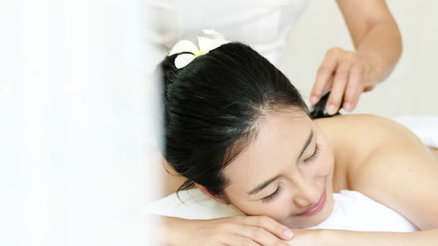 sophisticated spa treatment and massage for relaxation. - lastone therapy stock videos and b-roll footage