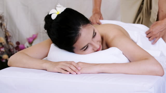 sophisticated spa treatment and massage for relaxation. - spa treatment stock videos & royalty-free footage