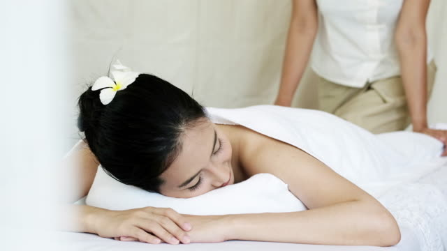 sophisticated spa treatment for relaxation. - massage oil videos stock videos and b-roll footage
