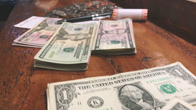 sorted amounts united states currency bills and coins counting for bank deposit 4k video series - five dollar bill stock videos & royalty-free footage