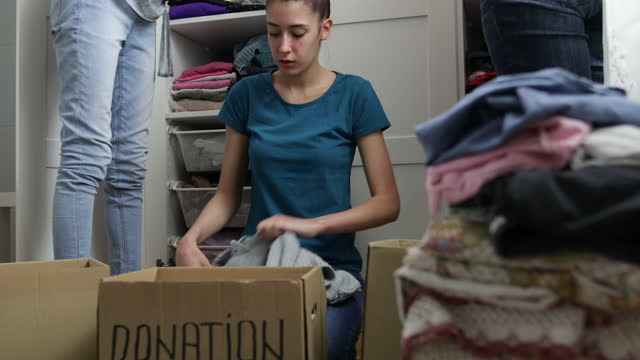 sorting clothes for donation - altruism stock videos & royalty-free footage