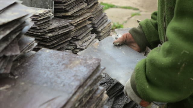 sorting rooftop tiles - slate rock stock videos and b-roll footage