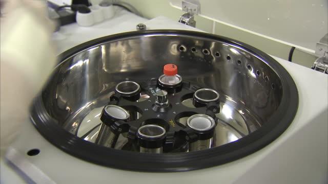 sorting test tube in centrifuge - zentrifuge stock-videos und b-roll-filmmaterial