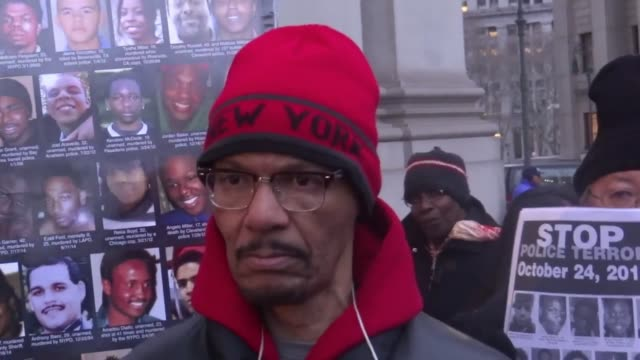 the black man in the red hat is nicholas heyward sr., whose son was killed by nypd 21 years ago; the white bearded man is travis morales from the... - crime or recreational drug or prison or legal trial点の映像素材/bロール