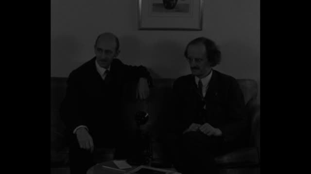stockvideo's en b-roll-footage met sots underwater explorer william beebe left and physicist/balloonist auguste piccard compare notes on their respective air balloon and underwater... - recordbrekend