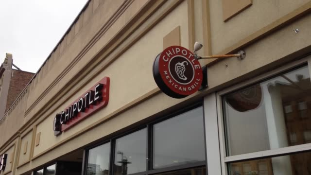 sots with two college students about the chipotle closed due to customer illnesses in boston . additional shots include the chipotle restaurant... - raw footage stock videos & royalty-free footage