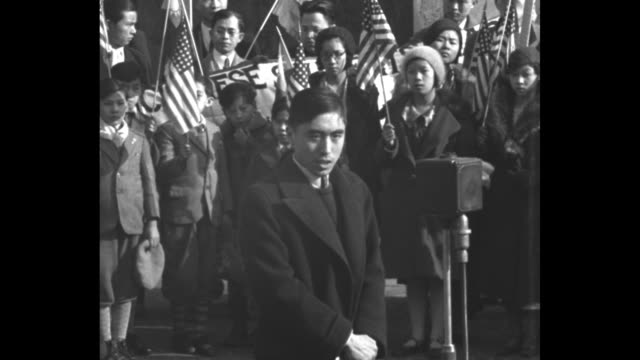 """sots y. l. chang talks about japanese in manchuria / sot miss l. h. loo also on japanese invasion of manchuria, calling it the """"granary of asia"""" /... - military invasion stock videos & royalty-free footage"""