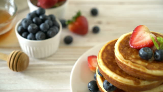 souffle pancake with fresh blueberries and strawberries - thai food stock videos and b-roll footage