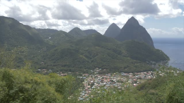 soufriere with the pitons, unesco world heritage site, st. lucia, windward islands, west indies caribbean, central america - st lucia stock videos & royalty-free footage