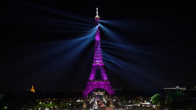 sound and light show is projected on the eiffel tower on may 15, 2019 in paris, france. to celebrate the 130th anniversary of the eiffel tower, the... - eiffel tower paris stock videos & royalty-free footage