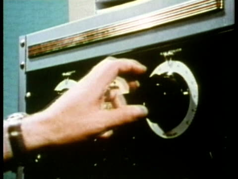 vidéos et rushes de 1969 cu sound booth technician adjusting dial on sound equipment during hearing test/ usa/ audio - audio disponible en ligne
