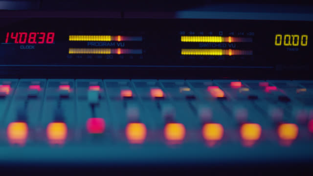sound engineer is working with sound control desk in studio - radio studio stock videos & royalty-free footage