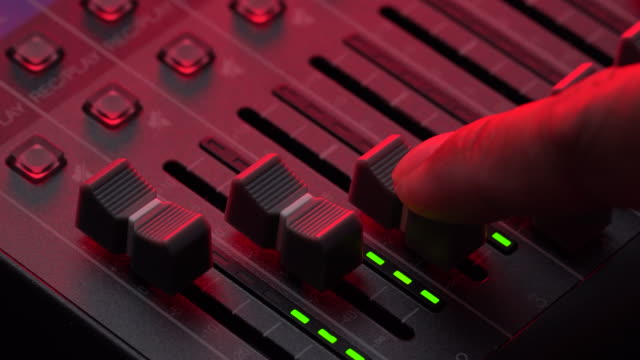 sound engineer moving level audio mixer - radio broadcasting stock videos & royalty-free footage