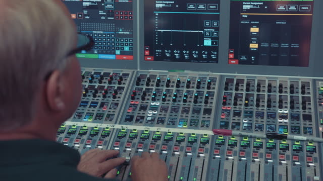 sound engineer operating an audio mixing desk in a live television broadcast studio on april 14, 2020. - technician stock videos & royalty-free footage