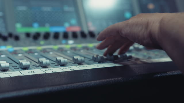 sound engineer operating an audio mixing desk in a live television broadcast studio on april 14, 2020. - workshop stock videos & royalty-free footage