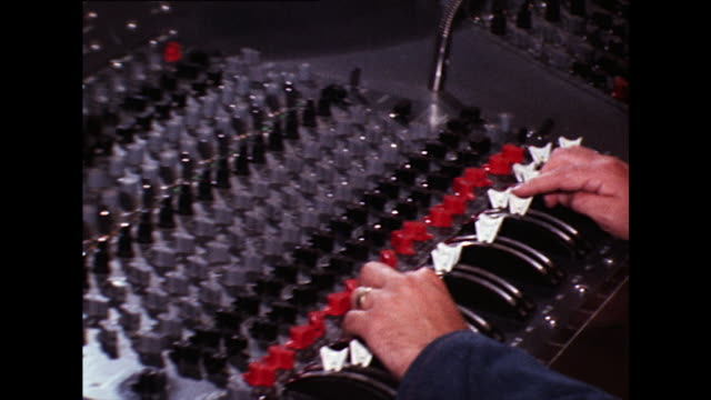 sound engineers working in a recording studio; 1973 - old stock videos & royalty-free footage