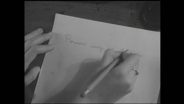 sound recorder playing, girl with headphones talking, hands writing on paper with pencil - 1940 1949 bildbanksvideor och videomaterial från bakom kulisserna