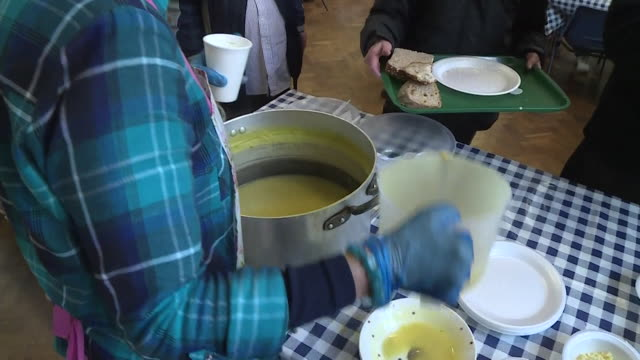 soup and bread being provided at a homeless shelter in london - homeless shelter stock videos & royalty-free footage
